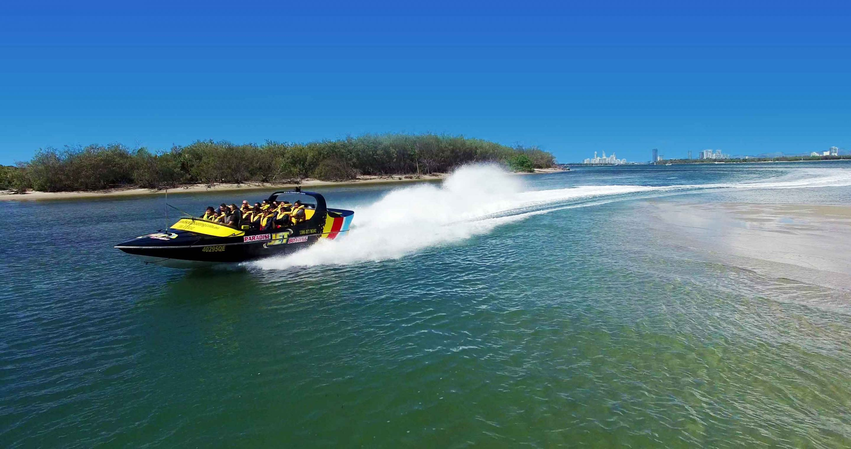 Jetboat full with customers zooming across the water