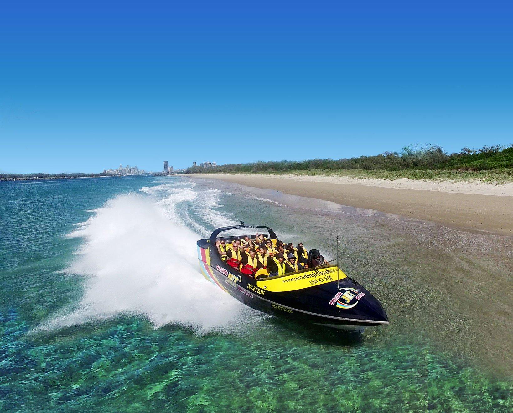 black jetboat cruising across the water