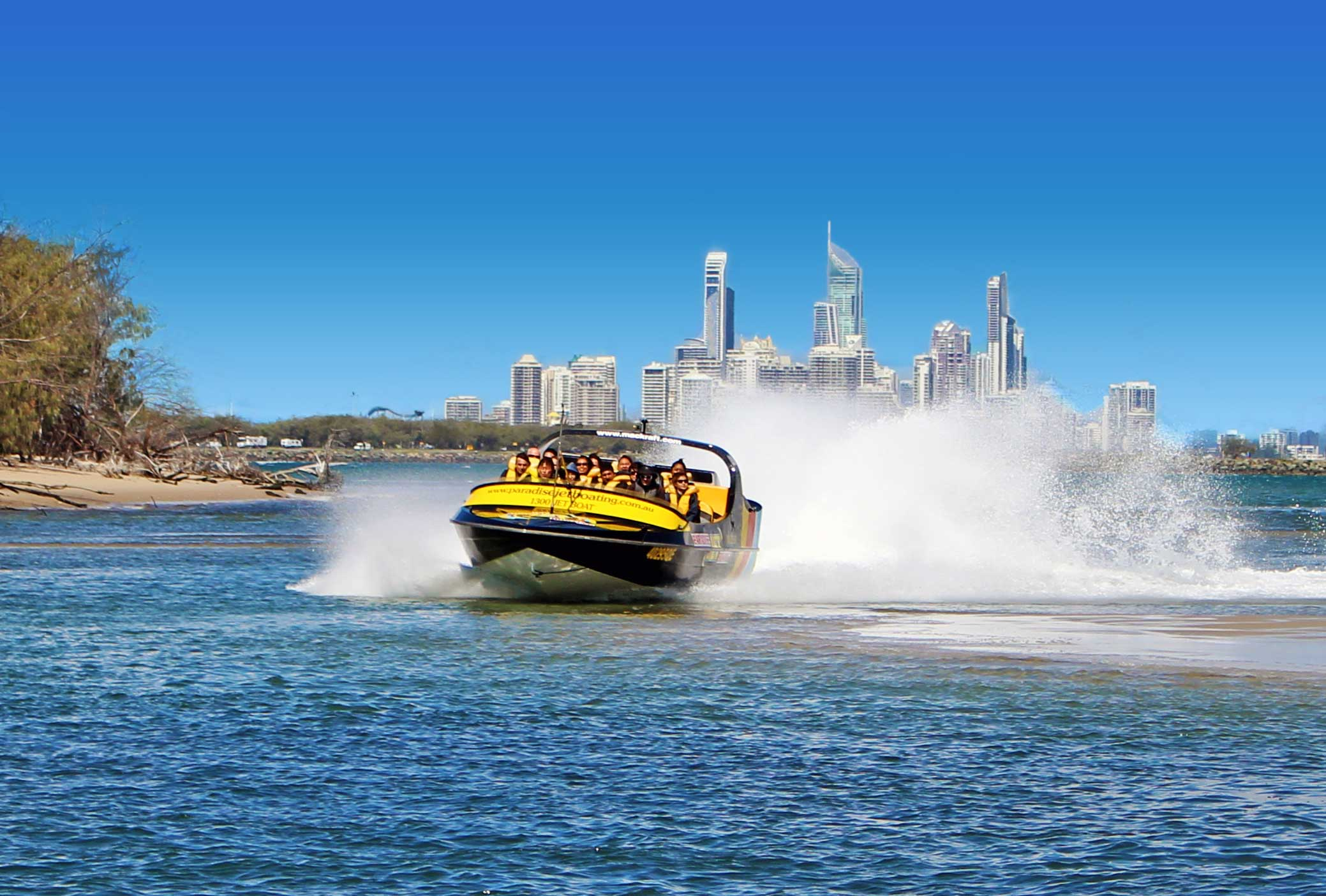 Black jetboat with Surfers Paradise Skyline in the background