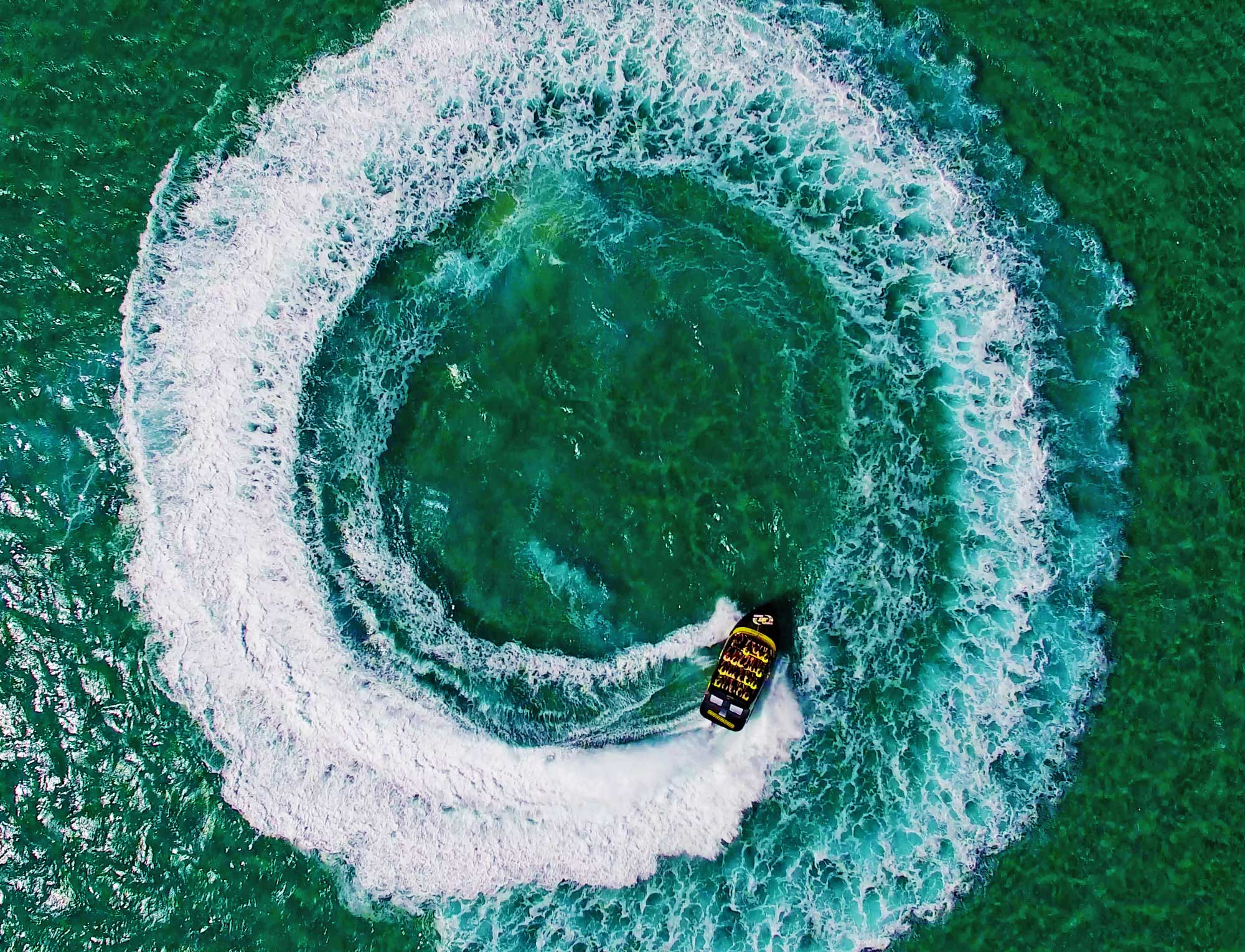 Jet boat doing donuts in the ocean