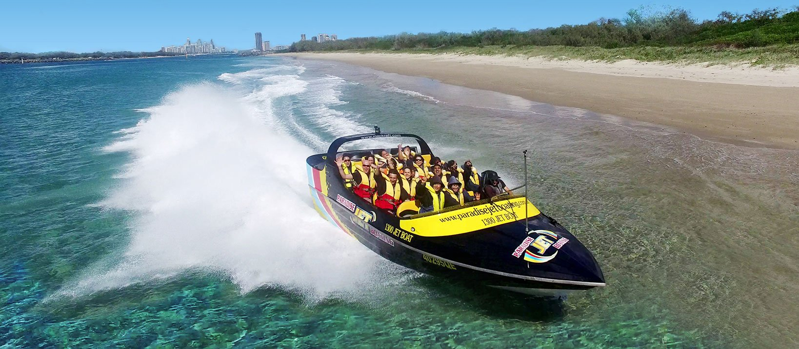 Jet boat on Gold Coast Australia full of customers on blue water