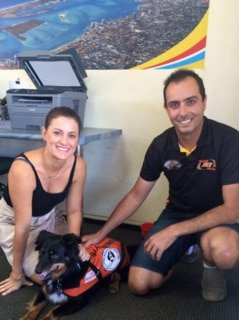 Jetboating staff looking after guide dog