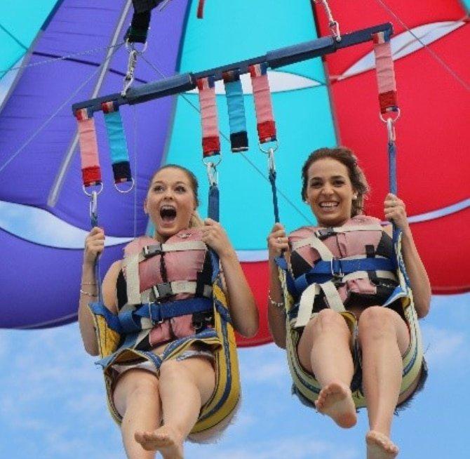 2 girls happy parasailing