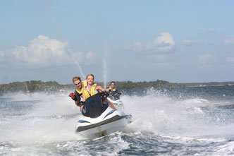 2 people on a jet ski